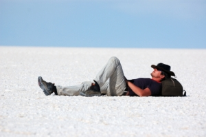 Young man relaxing in salt desert